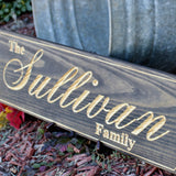 last name sign carved