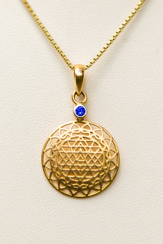 14kt Gold Sri Yantra Pendant Mounted with Blue Sapphire on 18kt Gold Chain