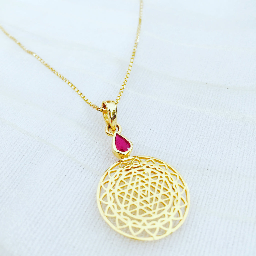 14 karat gold sri yantra pendant mounted with ruby on 18kt gold chain