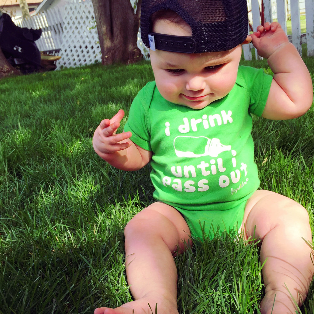 i drink until i pass out baby onesie in green on baby boy wearing trucker hat
