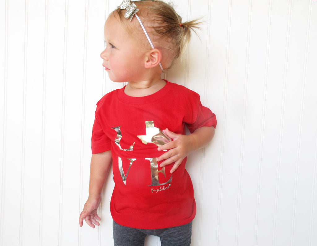 girl wearing red texas love shirt