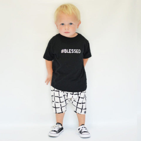 Boy wearing #blessed black t-shirt