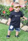 boy wearing blessed black shirt
