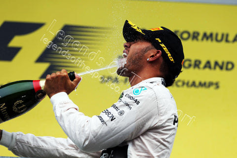 Formula 1 Print - Belgian GP Race Winner Lewis Hamilton celebrates on podium Sunday 23rd August Spa-Francorchamps Belgium - Legends Of The Sport