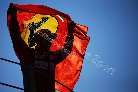 Formula 1 Print - 2015 Italian GP Sebastian Vettel (GER) Ferrari waves flag while celebrating 2nd position on the podium Sunday 6th September 2015 Monza - Legends Of The Sport