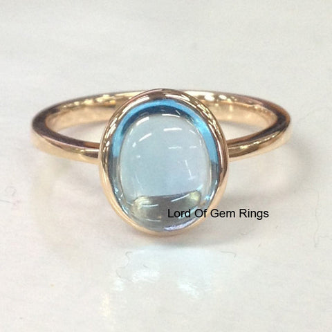 Oval Sky Blue Topaz Solitaire Bezel Set Engagement Ring 14K Rose Gold - Lord of Gem Rings - 1