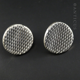 Concave Silver Disc Earrings with Hatched Design.
