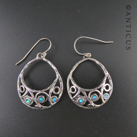 Opal and Silver Crescent Hoop Earrings.