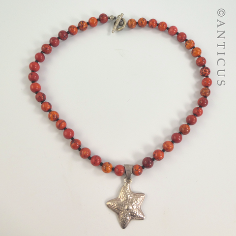 Coral Coloured Necklace with Silver Starfish Pendant.