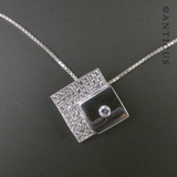 Diamond-Shaped Silver and Crystals Pendant on Chain.