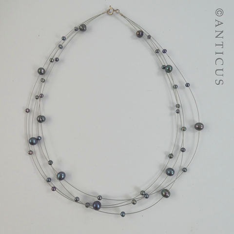 Black Pearl Four-Strand Floating Necklace.
