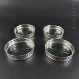 Four Sterling Silver and Cut Glass Drinks Coasters.