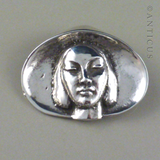 Cast Silver Brooch, Girl in Pipi Shell.