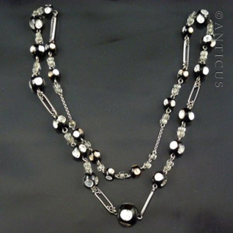 Black Venetian Glass and Silver Foiled Beads on Chain.