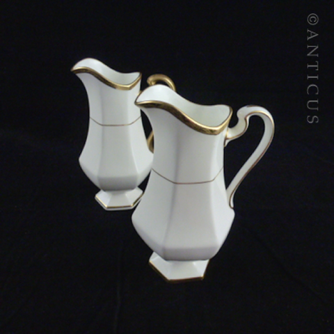 Pair of Minton Gold and White Jugs.