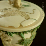 Carved Ivory Lidded Jar with Tigers and Elephants.