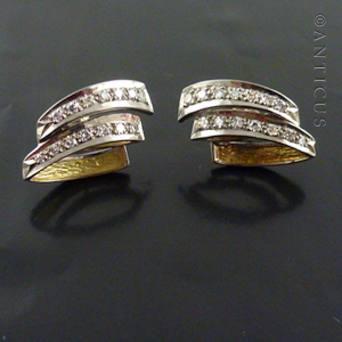 Pair of White Gold and Diamond Earrings.