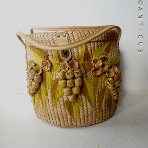 Large Round Raffia Lidded Basket with Nuts & Leaves Decoration.