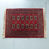Small Red Wool Bokhara Rug.