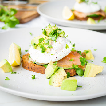 Paleo Bread topped with Poached Eggs, Avocado, Spinach and Salmon