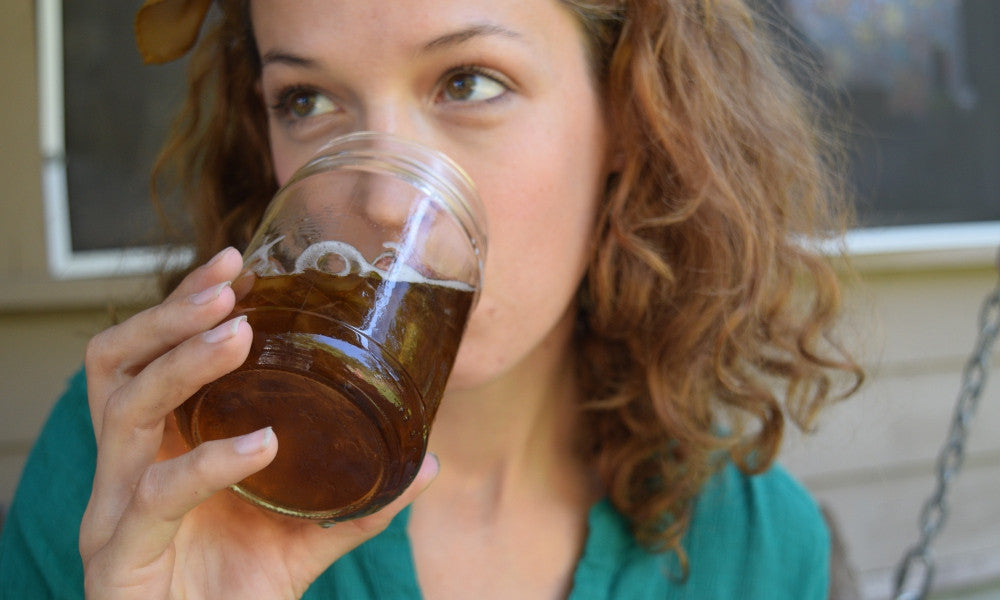 Young woman drinking yaupon iced tea