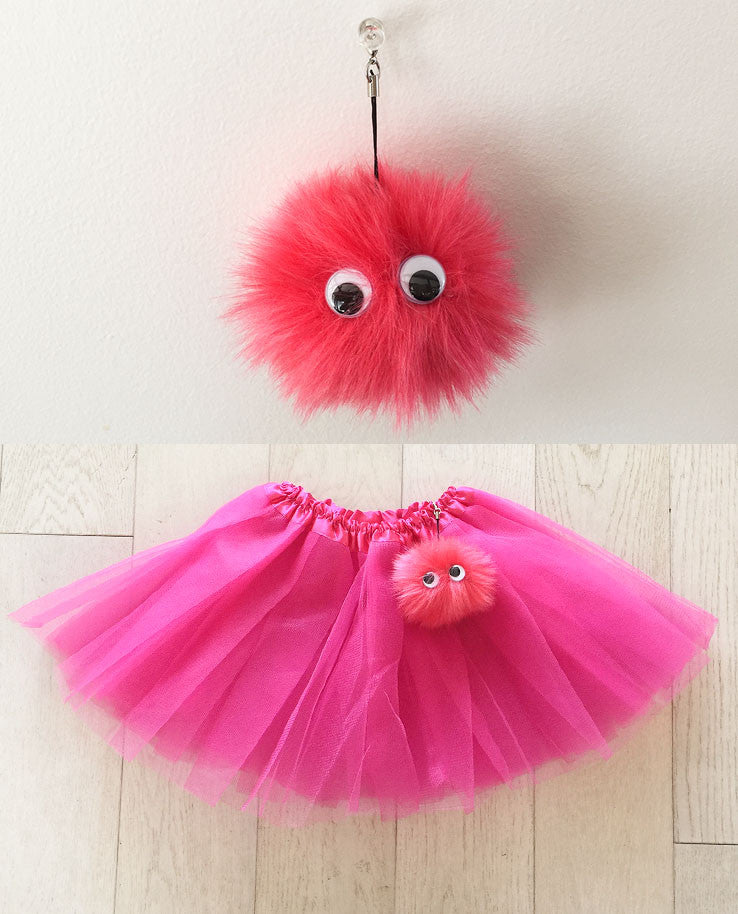 Pink tutu with faux fur pompom buddy