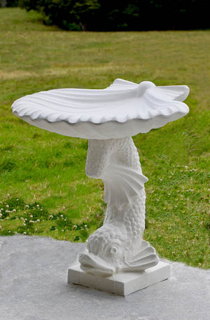 The Faraway Garden Salacia Bird Bath is a stunning pedestal bird bath with dramatic scallop shell bowl and fish shaped base. A beautiful showpiece for any garden setting; whether placed at the end of a formal green hedged pathway, on a terrace or in a rambling herbaceous border.