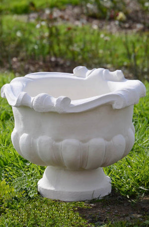 The Faraway Garden Grecian Urn is an elegant garden planter inspired by the classical aesthetic of Ancient Greece with its distinctive scrolling on the rim and gadrooning design on bowl. Perfect aged with our sepia wash.  This unique garden planter would look gorgeous as part of a group or positioned on one of Faraway Garden's pedestals.