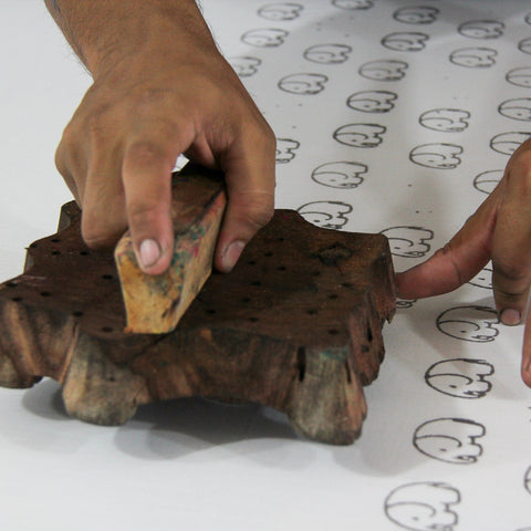 Wood block-printing by hand onto cotton material