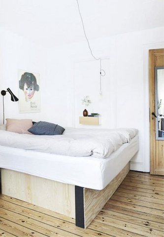 Whit Scandinavian bedroom with simple floating bedside