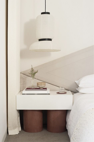 Modern bedside with ceramic bowl and glass of water