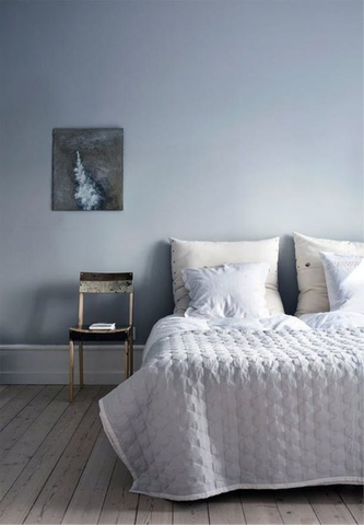 Scandinavian bedroom with book on bedside chair