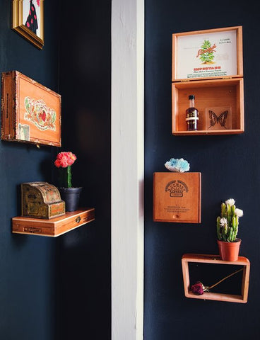 cigar boxes on wall
