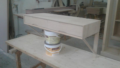 Finishing a bedside at our workshop