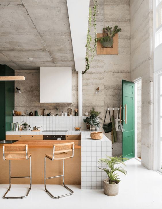 eco house open kitchen area concrete walls green accents