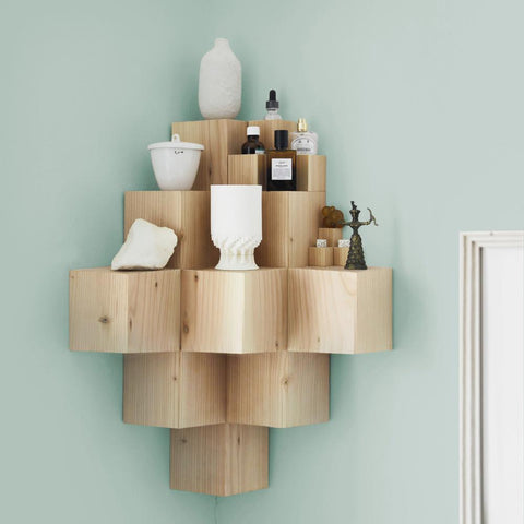 wooden corner shelf with knick knacks