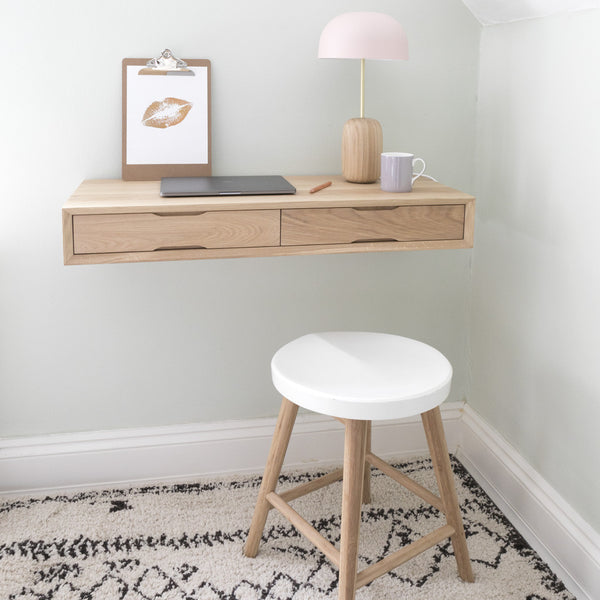 floating oak desk with white stool