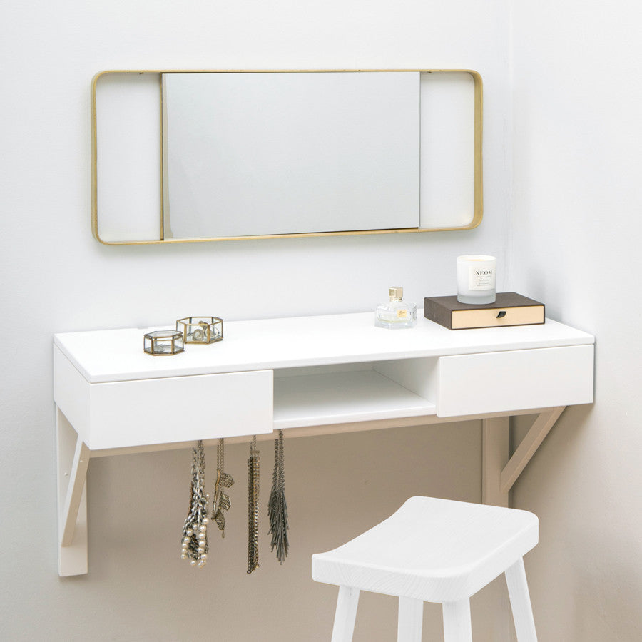 white floating dressing table with gold mirror