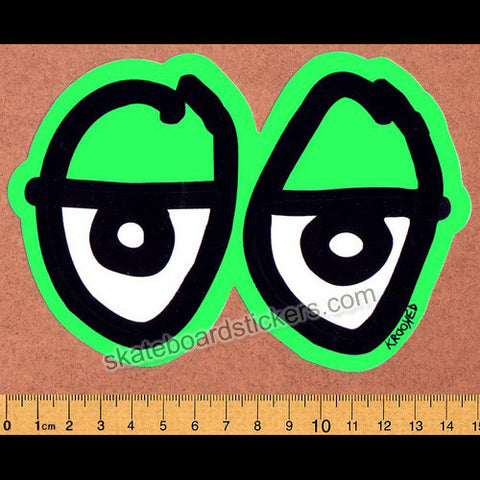 Krooked Green Eyes Skateboard Sticker - SkateboardStickers.com
