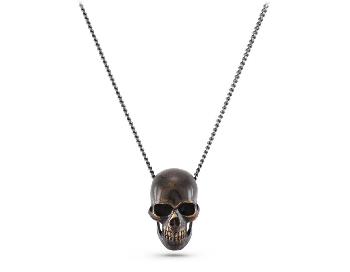 de set necklace brass skull with products monserat and brain lucca