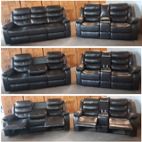 Sofa Set in a Black PU Material with Drop Down Cup Holders in the Sofa and Console in the Love Seat