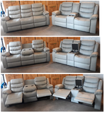 Sofa Set in a Grey PU Material with Drop Down Cup Holders in the Sofa and Console in the Love Seat