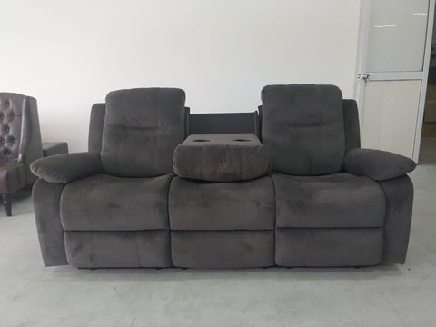 Grey Microfiber Sofa Set Featuring a Drop Down Cup Holder in the Sofa a Console in the Love Seat and a Glider Reclining Chair.