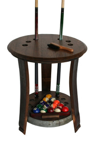 Wine Barrel Pool Cue Rack made from reclaimed wine barrel stave. Holds 6 pool stick and 1 rack of pool balls. This pool cue rack is stained in pine and has an upper shelf and lower shelf. The lower shelf has metal accents around the outside .