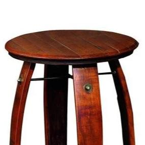 Wine Barrel Side Table Made from Reclaimed wine barrel staves. The table is 28 inches tall and 23 inches in diameter and is stained in pine. It has a lower shelf for storage. The item is made by hand in America by 2 Day Designs
