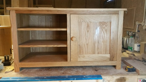 Solid Oak TV unit with cupboard and shelf area