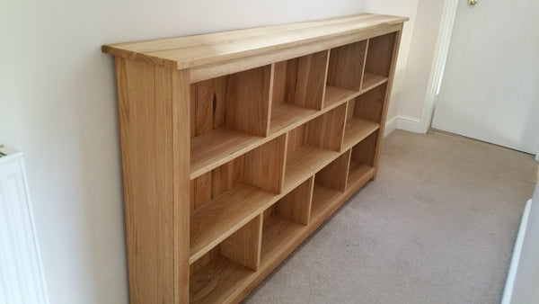 Oak bookcase with sections, slimline, ideal for hall or lounge.