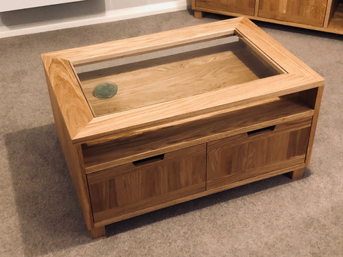 Exclusive range coffee table with glass top and cupboards ideal for the, living room, lounge or bedroom.