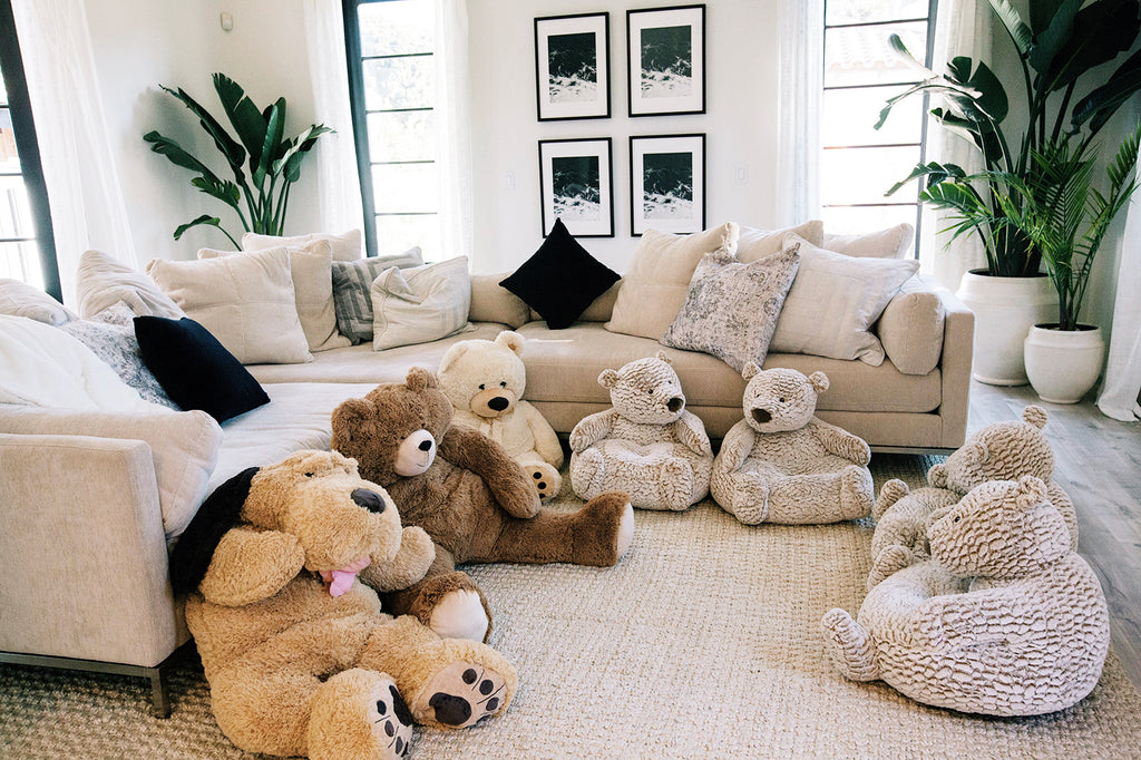 We filled our family room with these huge stuffed animals and bears so the babies could have a little space to have playtime with each other! Alessandra and her baby friends had the best time rolling around in here with each other!
