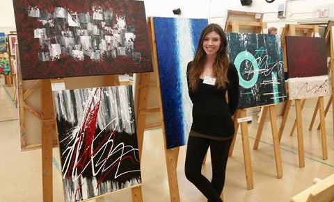 Nicole Nicholas showcasing her abstract art at the show